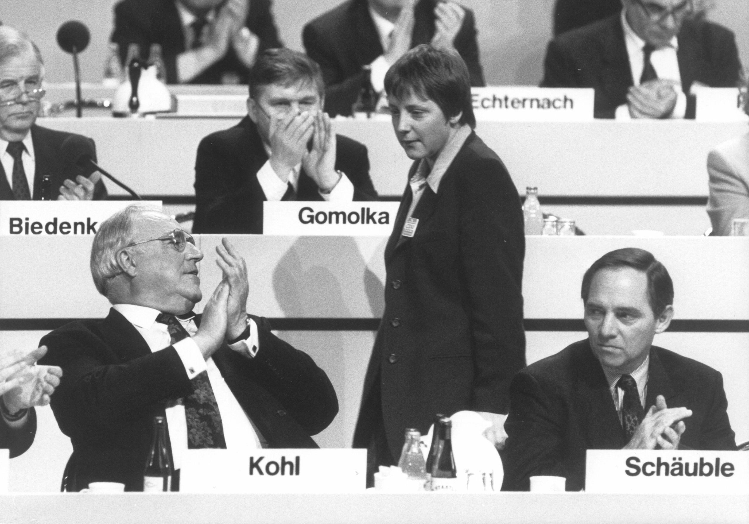 Party leader Helmut Kohl with his representitive Angela Merkel and head of the party Wolfgang Schaeuble at a CDU conference, Dezember 21, 1991, Dresden, Germany.  (Photo by Thomas Imo/Photothek via Getty Images)