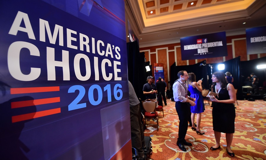Journalists speak back stage ahead of the Democratic presidential debate at the Wynn Hotel in Las Vegas, Nevada on October 13, 2015, hours before the first Democratic Presidential Debate. After ignoring her chief rival for months, White House heavyweight contender Hillary Clinton steps into the ring Tuesday to confront independent Senator Bernie Sanders in their first Democratic debate of the 2016 primary cycle. Clinton will take center stage in Las Vegas joined by Sanders and three other hopefuls, and while there is unlikely to be a dramatic clash of personalities as seen in the first two Republican debates, the spotlight is likely to be on the top two candidates. The other three challengers -- former Maryland governor Martin O'Malley, ex-senator Jim Webb and former Rhode Island governor Lincoln Chafee -- will try to generate breakout moments to show they are electable alternatives to Clinton. AFP PHOTO / FREDERIC J. BROWN        (Photo credit should read FREDERIC J. BROWN/AFP/Getty Images)