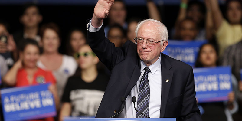 Democratic presidential candidate, Sen. Bernie Sanders, I-Vt., waves to his supporters at a campaign rally Tuesday, March 8, 2016, in Miami. (AP Photo/Alan Diaz)